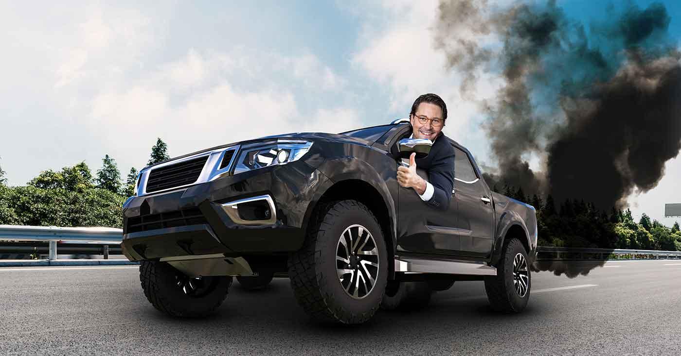 Kampagnengrafik Verkehrswende: Scheuer mit stinkendem Dieselmotor