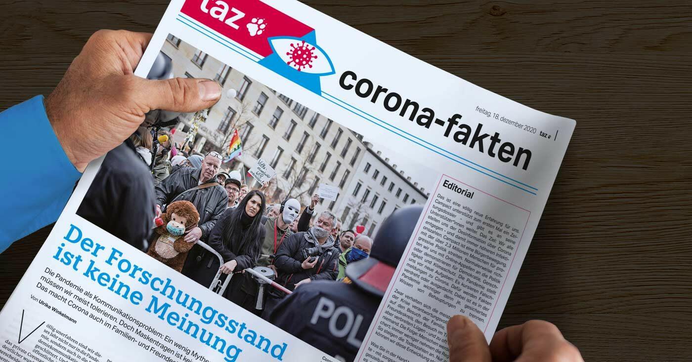 Ein Mensch hält eine Zeitung in den Händen - das Corona-Dossier der taz.
